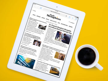 The Daily Memphian website on an ipad next to coffee cup